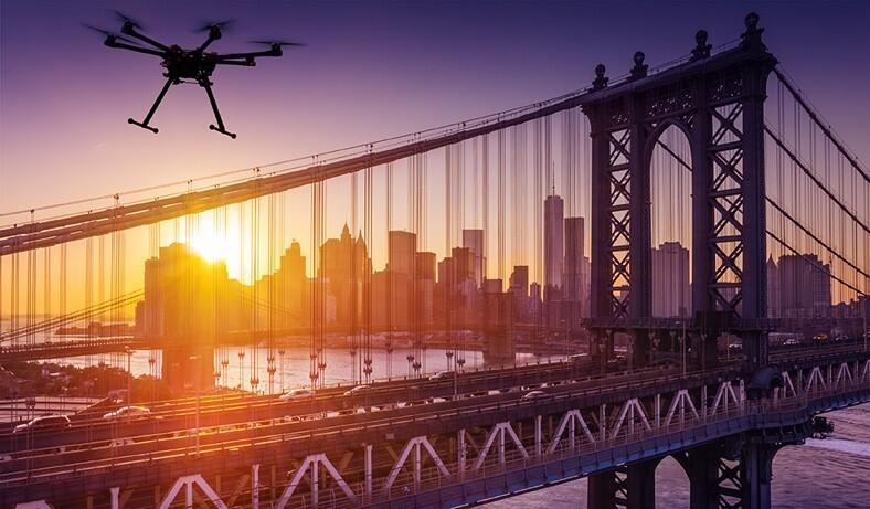 UAS flying near a bridge in New York City (Source: DHS)