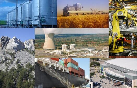 Collage of various critical infrastructure: chemical tanks, harvester in a wheat field, Mount Rushmore, nuclear power plant, robot at a manufacturing plant, and barge full of shipping containers at a port..